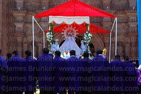 Devotees of Señor de los Milagros paying respect to Virgen de la Candelaria after central mass, Puno, Peru