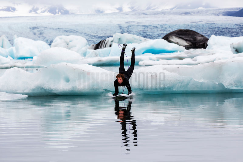 Surfer Entering Glacial Lagoon