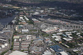 Manchester aerial photograph of Trafford Park Industrial Estate looking down Trafford Park road and Wharfside Way towards Manchester United football Stadium