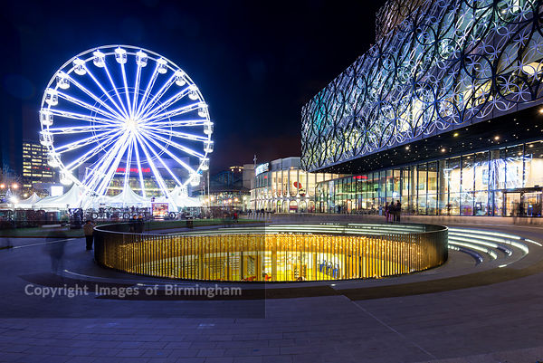 The library of Birmingham in Centenary Square, Birmingham, England, and ferris wheel.