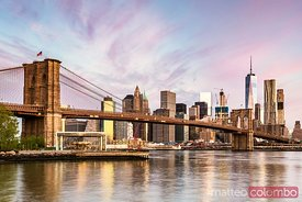 Brooklyn bridge and lower Manhattan skyline at sunrise, New York, USA