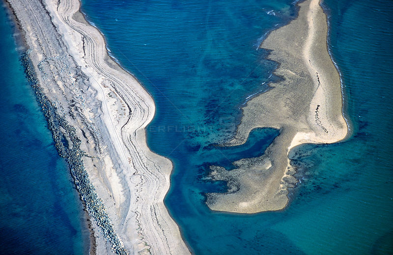Aerial view of Sillon de Talbert, a sand and pebble barrier beach, at high tide. Pleubian, Cotes d'Armor, Brittany, France.