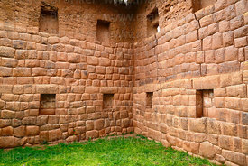 Inca wall and niches in 2 storey building in Huchuy Qosqo site, Cusco Region, Peru