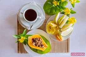 Food: breakfast with papaya and tropical fruit