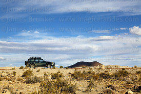 Toyota Land Cruiser parked in desert near Jayu Quta, Oruro Department, Bolivia