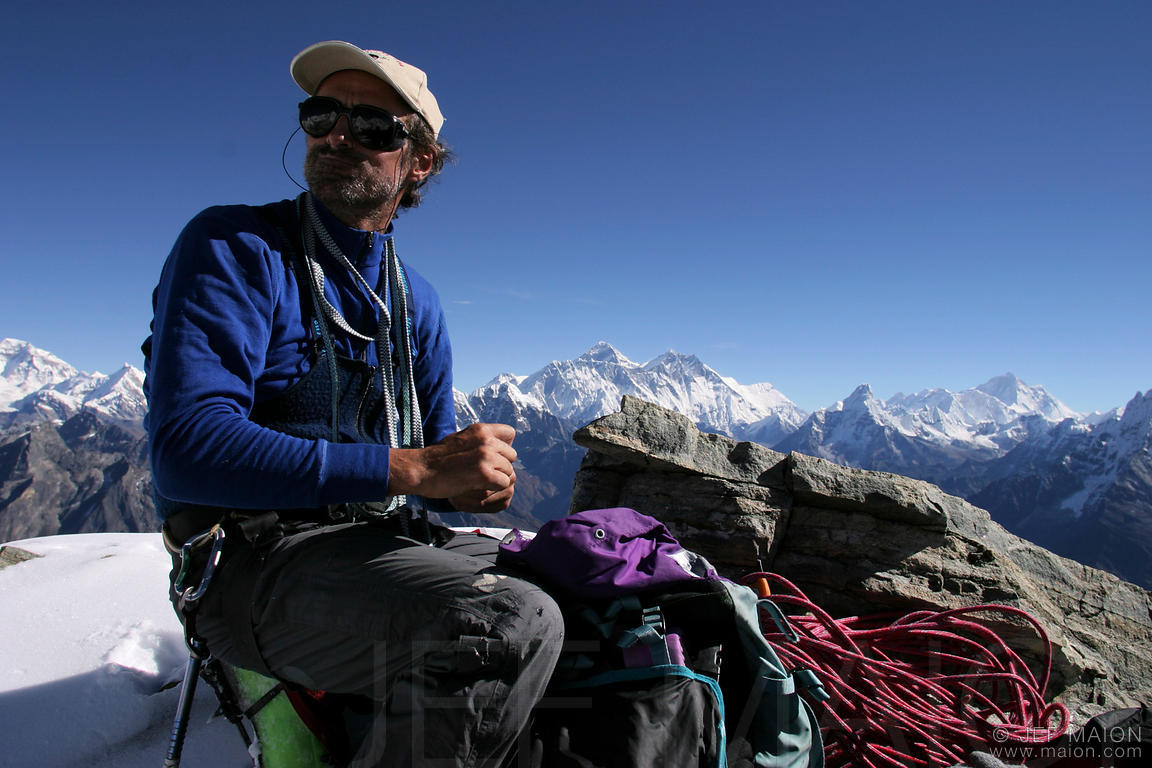 Alpinist on top of Nupla, Mt Everest in background