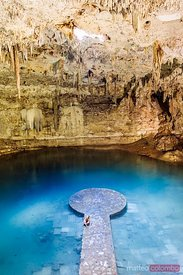 Woman inside a cenote, Yucatan, Mexico