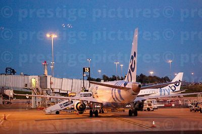 Flybe Plane by the Terminal at Edinburgh Airport at night