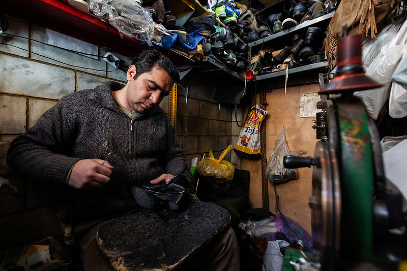 Portrait of a Cobbler in his Shop