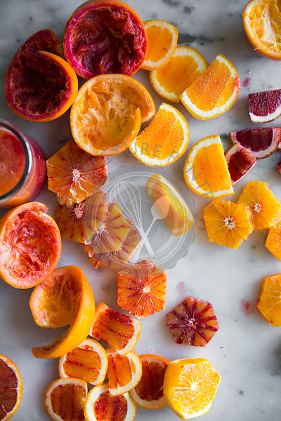 Peeled blood oranges for a fruit juice drink