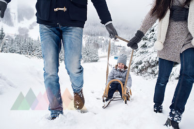 Family with sledge in winter landscape