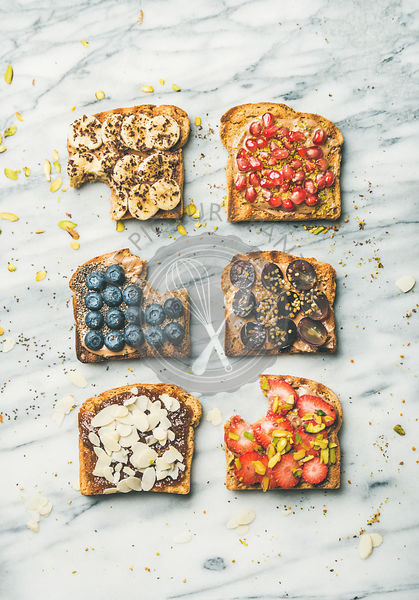 Healthy breakfast or snack with wholegrain toasts, top view
