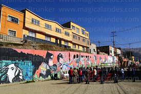 Priest saying mass in front of mural in residential suburb, La Paz, Bolivia