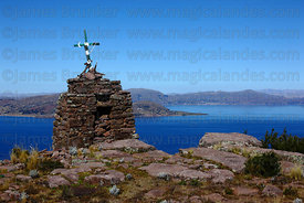 Pre-Inca cairn on summit of Cerro Carus, Capachica Peninsula, Lake Titicaca, Peru