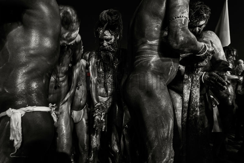 Naga Sadhus Covering themselves with Ash after a Holy Dip in the Ganges