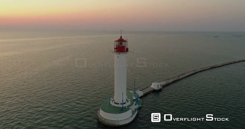 Drone flies around the Odessa Lighthouse at dawn.  Ukraine