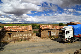 Truck passing adobe / mud brick houses in Belén village, Potosí Department, Bolivia