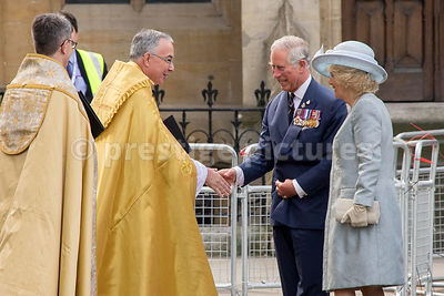 Prince Charles and Camilla are Greeted by The Dean of Westminster at the National Service of Thanksgiving