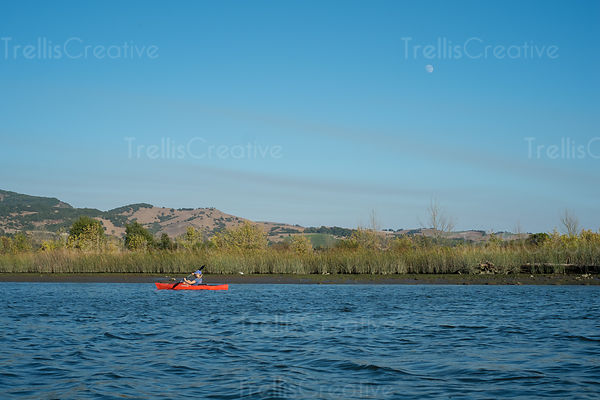 Kayaking on the Napa River, under the blue sky