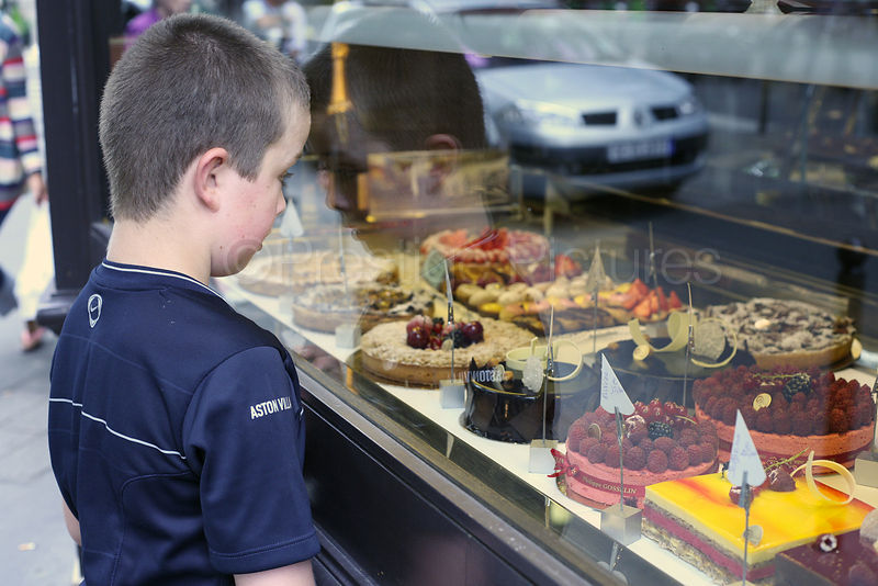 Boy Staring at a Parisienne Pâtisserie Window Display
