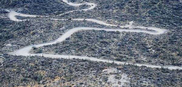Aerial photograph of a curvy mountain road in Tucson Mountain Park, Arizona.
