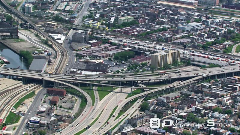 Zoom-out from overhead view of freeway interchange to Chicago skyline.