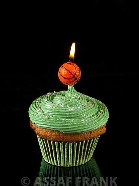 Cupcake with basketball shaped candle