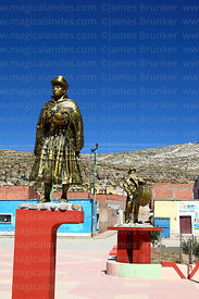 Statue of local woman in traditional dress in village square, Curahuara de Carangas, Oruro Department, Bolivia