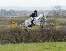 Annie Bellamy jumping a hedge at Sheepwash - The Belvoir at Mount Pleasant
