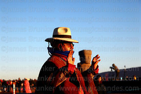 An Aymara leader holds up his hands to receive the sun's energy at sunrise during Aymara New Year celebrations, Tiwanaku, Bolivia