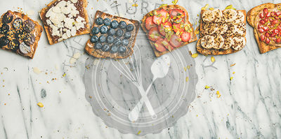 Vegan whole grain toasts with fruit, seeds, nuts, copy space
