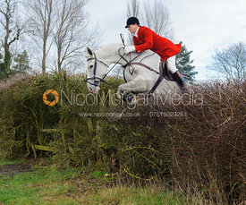 Nicholas Leeming MFH jumping the first hedge - Barleythorpe