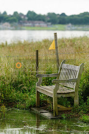 Bench at Rutland Water shows how high reservoir levels have reached.