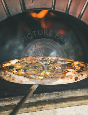 Freshly baked pizza with vegetables in wood oven