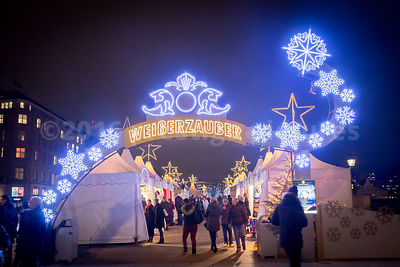 Bright White Illuminated Snowflakes decorate the entrance to the White Magic Christmas Market