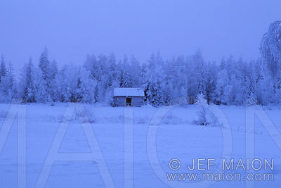 Field and hut in snow