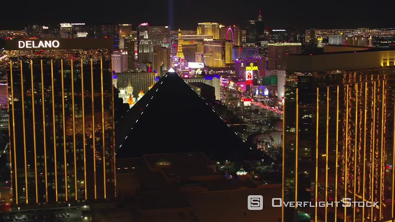 Las Vegas, Nevada Fly by Mandalay Bay hotel and casino revealing Las Vegas Strip at night.  Shot with Cineflex and RED EpicW Helium.