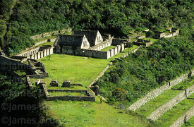 View of main plaza and stone buildings called kalankas at Inca site of Choquequirao, Peru