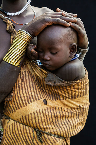 Mursi Woman Holding Her Child in Goatskin
