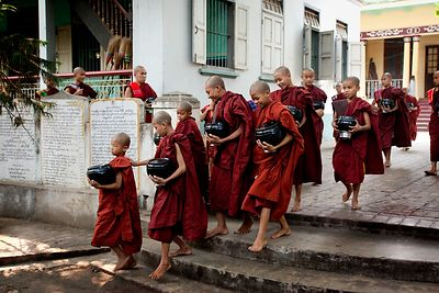 Young buddist monks in the largest monastery of Mandalay walk to the diningroom to have their only meal of the day, after collecting alms from local people.