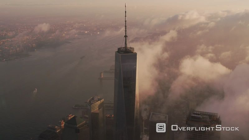 New York City Sunrise over Manhattan with clouds passing One World Trade Center building.  Shot with Cineflex and RED EpicW Helium.