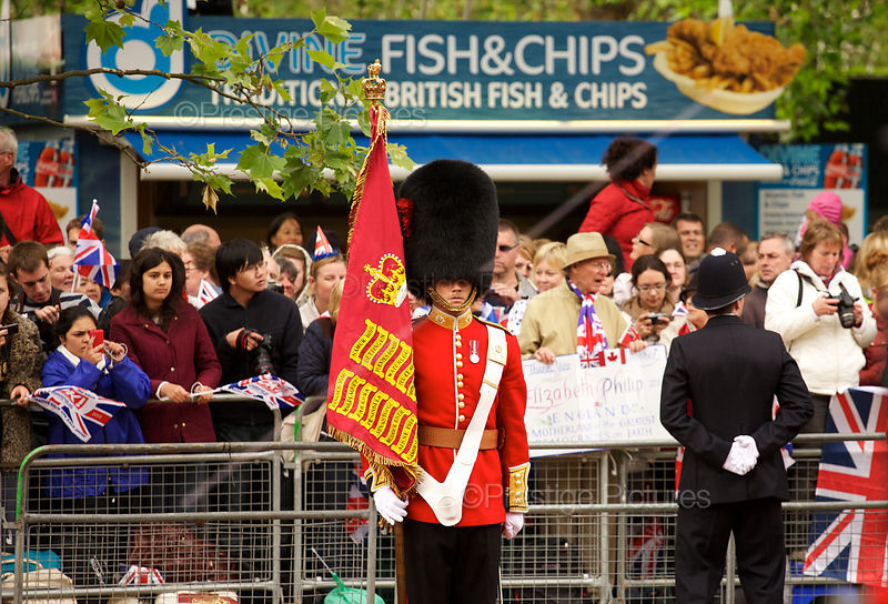 Coldstream Guard stands to Attention in The Mall with Fish & Chip Stall behind