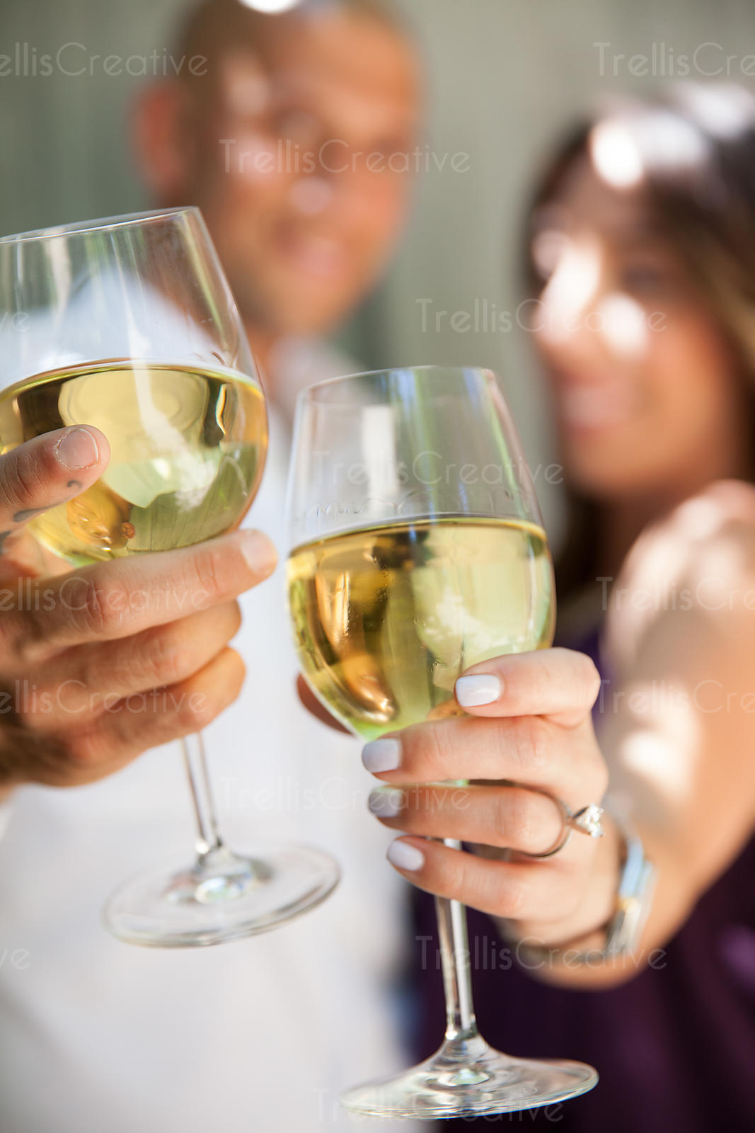 Young man and woman drinking white wine