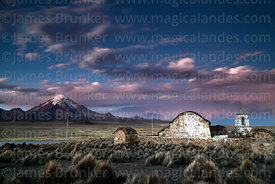 Rustic church near Lagunas at sunset, Sajama volcano in background, Sajama National Park, Bolivia