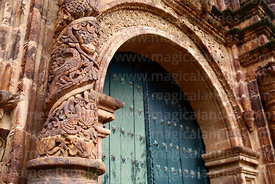 Detail of lion, bird and grape carvings on pillar of main side entrance facade of St John the Baptist of Letrán / San Juan Bautista de Letrán church, Juli, Puno Region, Peru