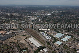 Birmingham high level wide angle aerial photograph of the M6 motorway running west and railway stock yard industrialisation  Spaghetti Junction Gravelly Hill in distance