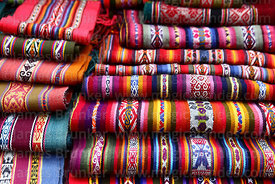 Ethnic weavings for sale on market stall, Cusco, Peru