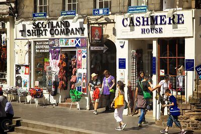 Pedestrians passing by two Scottish Gift Shops
