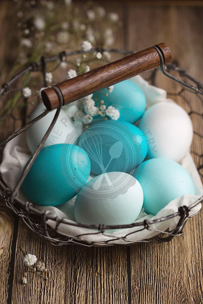 Dyed Easter eggs in a wire basket