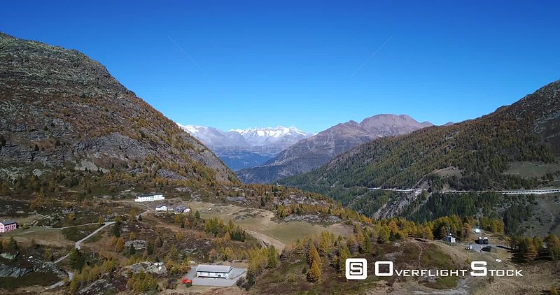 Alpine Landscape, 4k Aerial View Over the Top of Simplon Pass and Towards Snowy Mountains, Sunny Autumn Day, Valais, Alps of Switzerland